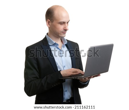 Portrait of young businessman with laptop isolated over white background
