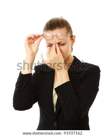Portrait of young businesswoman having headache pains isolated on white background - stock photo