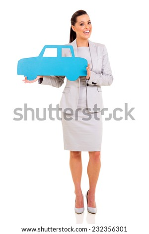 portrait of young businesswoman holding a car symbol - stock photo