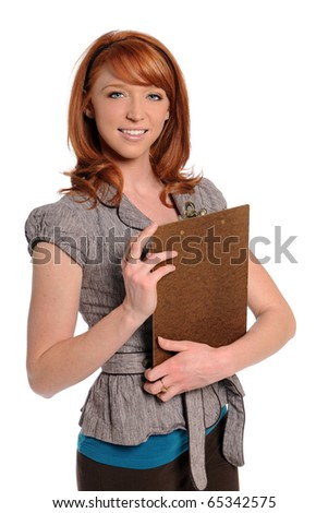 Portrait of young businesswoman holding clipboard isolated over white background - stock photo