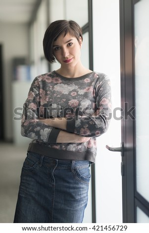 portrait of  young businesswoman in casual hipster clothes at modern startup business office interior - stock photo