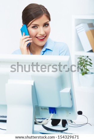 Portrait of young businesswoman in office on phone. Female business style posing model.