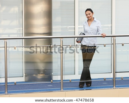 portrait of young businesswoman in office space smile
