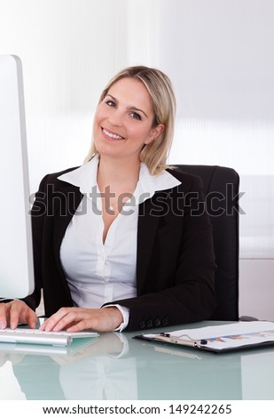 Portrait Of Young Businesswoman Using Computer In The Office