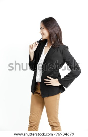 portrait of young businesswoman with a pen in her hand - stock photo