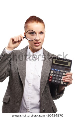 portrait of young businesswoman with calculator and magnifying glass - stock photo