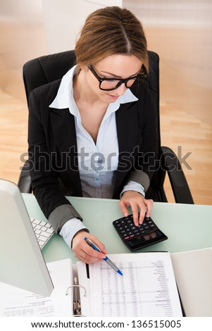 Portrait Of Young Businesswoman Working In Her Office - stock photo