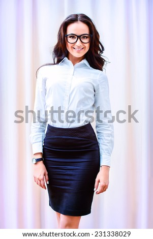 Portrait of young businesswoman working in the office. - stock photo