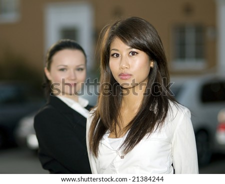 Portrait of young businesswomen outdoors, selective focus - stock photo