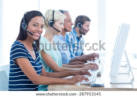 Portrait of young casual call centre workers in the office - stock photo