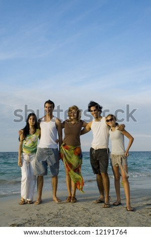 Portrait of young casual teenagers standing on the beach