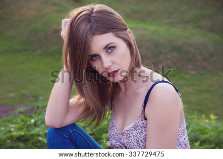 Portrait of young caucasian beautiful brunette girl. Outdoors.