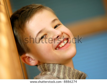 Portrait of young, caucasian boy smiling - stock photo