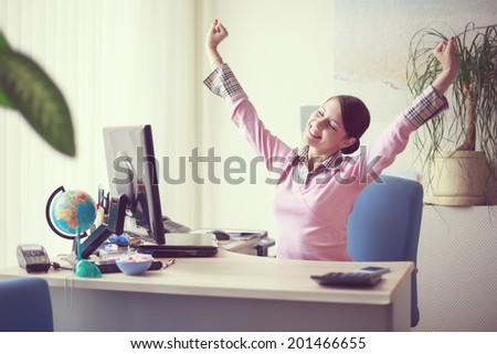 Portrait of young caucasian business woman in pink vest at her office