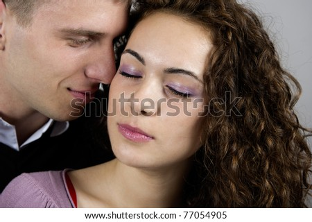 portrait of young caucasian couple on gray background - stock photo