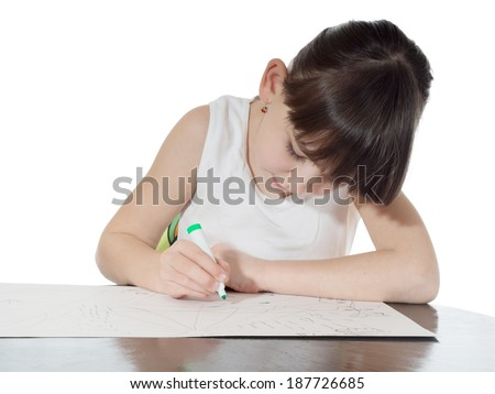 Portrait of young caucasian girl drawing picture by felt-tip pen on the table isolated on white