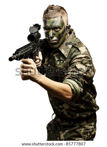 portrait of young caucasian soldier with jungle camouflage over white background - stock photo