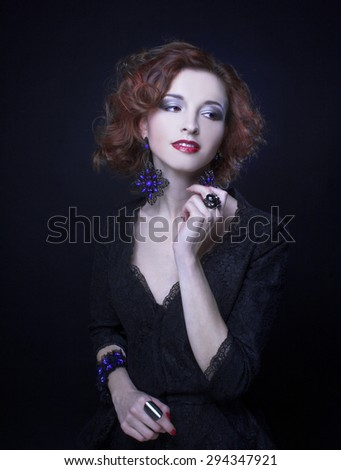Portrait of young charming woman in black dress