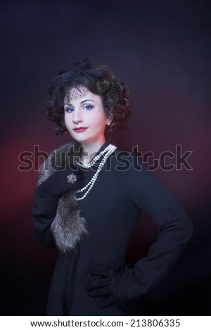 Portrait of young charming woman in elegant retro image.