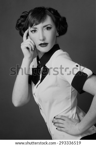 Portrait of young charming woman in retro style