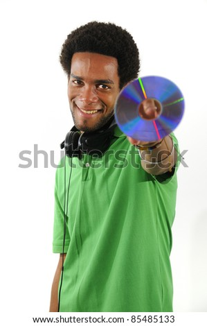 Portrait of young cheerful african american man holding CD/DVD isolated over white - stock photo