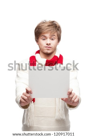 portrait of young cheerful caucasian man which holding sign with funny expression
