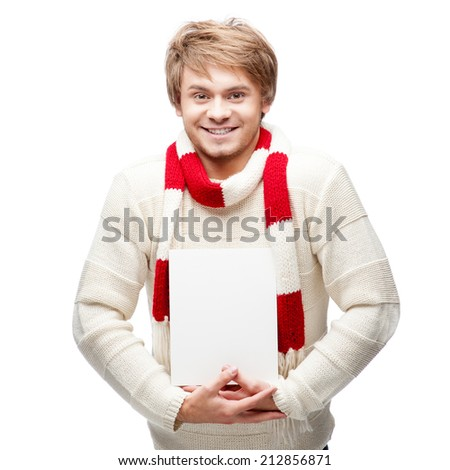 portrait of young cheerful happy caucasian man which holding sign with nice smile - stock photo