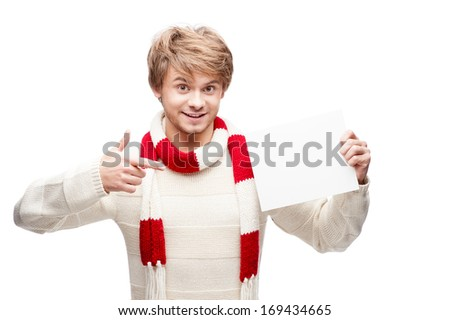 portrait of young cheerful smiling caucasian man which pointing at sign with nice smile - stock photo