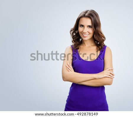 Portrait of young cheerful woman. Blank copyspace area for advertising slogan or text message. Caucasian brunette model in emoshions and optimistic, positive, happy feeling concept studio shoot.