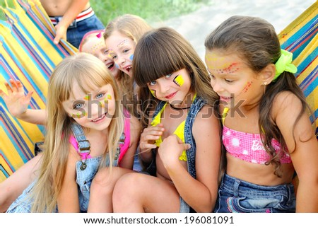 Portrait of young children on a camping holiday