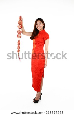 Portrait of young Chinese woman in traditional red Cheongsam, isolated on white background - stock photo