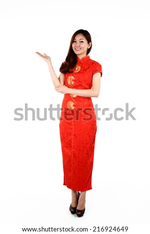 Portrait of young Chinese woman in traditional red Cheongsam presenting, isolated on white background - stock photo