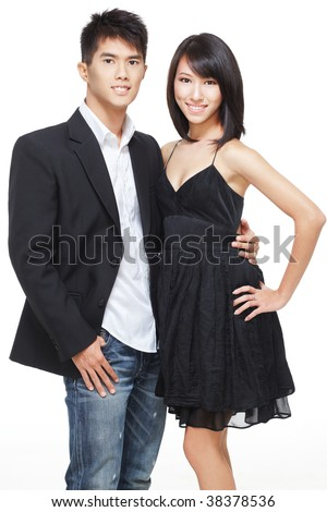 Portrait of young, Chinese working couple dressed up for date and party. Shot in studio isolated on white - stock photo