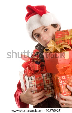 Portrait of young christmas boy holding a lot of gifts isolated on white background - stock photo