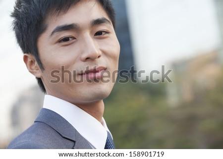 Portrait of young confident businessman - stock photo