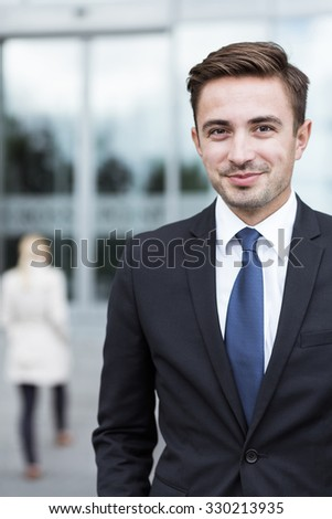 Portrait of young confident businessman outside office - stock photo