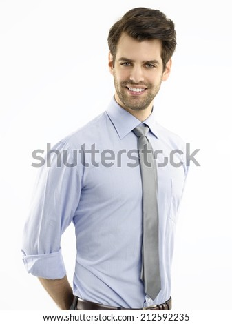 Portrait of young confident businessman standing against white background. Business people.