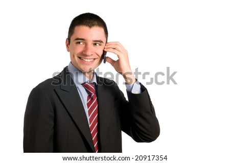 Portrait of young confident businessman talking on mobile phone isolated on white background - stock photo