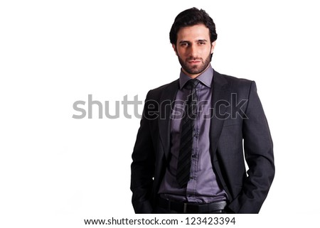 portrait of young confident businessman with copy space isolated on white.
