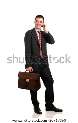 Portrait of young confident businessman with phone and working bag isolated on white background