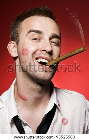 portrait of young confident man smoking cigar - stock photo