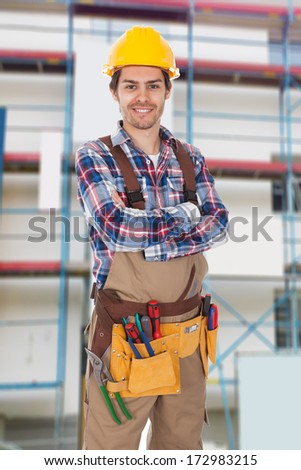 Portrait Of Young Construction Worker With Tool Belt - stock photo