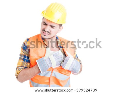Portrait of young constructor holding his chest in pain as heart-attack or illness concept isolated on white - stock photo