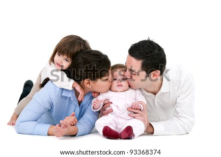 Portrait of young couple and their daughters. Isolated on white background.