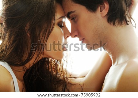Portrait of young couple face to face - stock photo