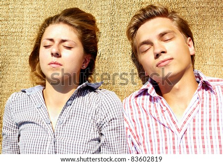 Portrait of young couple having a nap - stock photo