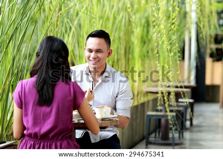 portrait of young couple having lunch together with copy space - stock photo