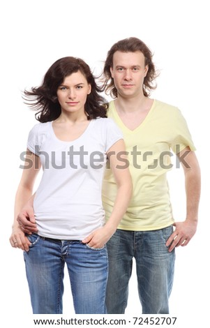 Portrait of young couple in jeans, serious boy embraces girl