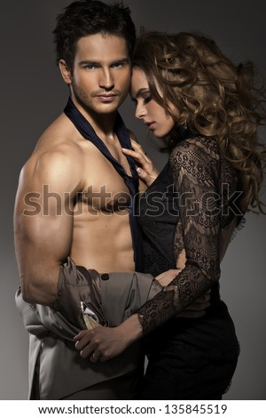 Portrait of young couple in love posing - stock photo