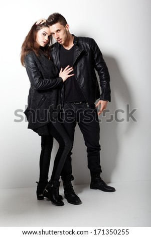 Portrait of young couple in love posing at studio
